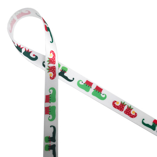"Adorable little elf shoes in holiday colors of red, green and black printed on 5/8"" white single face satin ribbon is and ideal addition to your Holiday gifts, crafts, favors and decor!"
