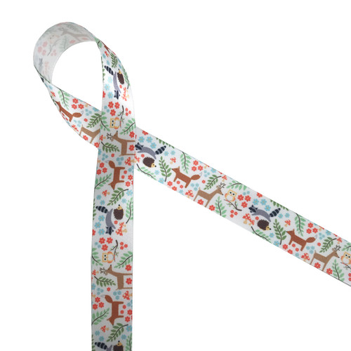 "Woodland animals on 7/8"" white satin ribbon feature raccoon, deer, fox, owls and hedgehogs scattered among leafy branches, flowers and mushrooms!"