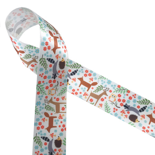 """Woodland animals on1.5"""" white satin ribbon feature raccoon, deer, fox, owls and hedgehogs scattered among leafy branches, flowers and mushrooms! This is a great ribbon for baby showers, nurseries, gift wrap, quilting  and first birthday parties. Our ribbon is designed and printed in the USA"""