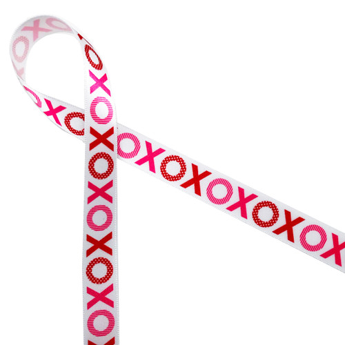 "Valentine X's and O's in shades of pink and red with features of stripes and polka dots printed on 5/8"" white single face satin ribbon. Hugs and kisses are special every day, but these Valentine hugs are extra warm and wonderful! Be sure to have this fun ribbon on hand for your Valentine celebrations!"