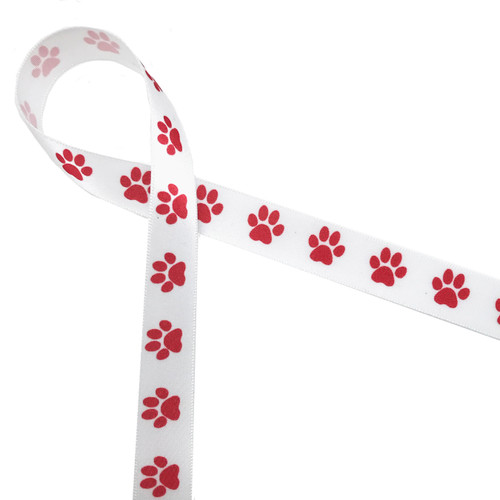 "Red paw prints in a row printed on 5/8"" white single face satin ribbon is the cutest little ribbon for pet gifts and favors for any occasion, but especially for Valentine's Day and Christmas!"