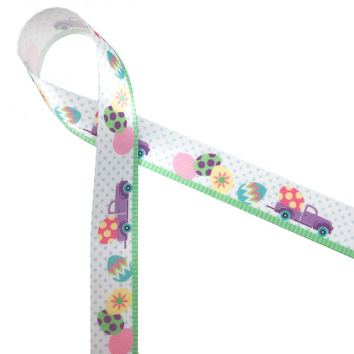 "Lavender Egg truck with a large Easter egg in the flat bed and eggs along the ground drives along  Spring green grass and a polka dot background printed on  7/8"" white single face satin ribbon. What a fun ribbon for Easter baskets!!"