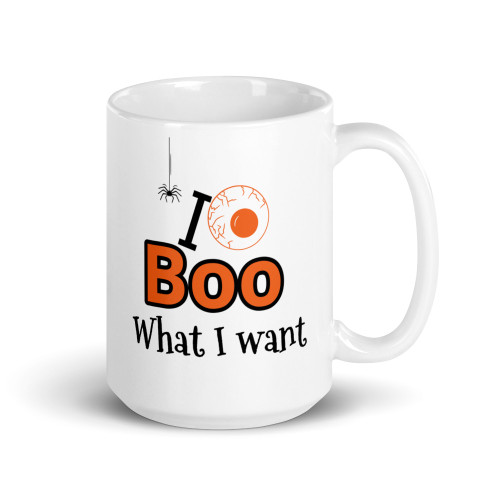 Right side of all white coffee mug with I boo what I want on it.