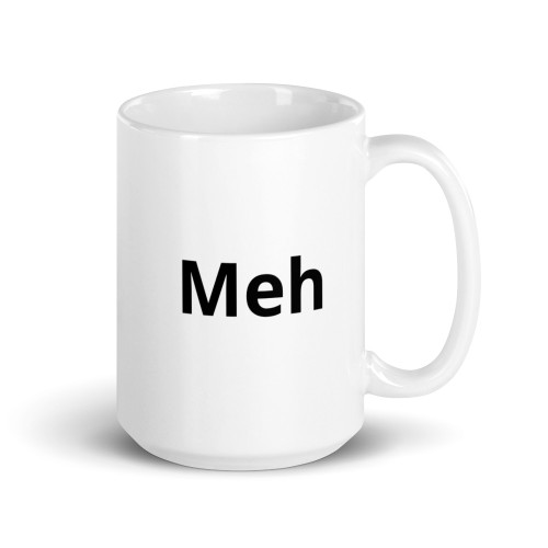 Right side of all white coffee mug with meh on it.