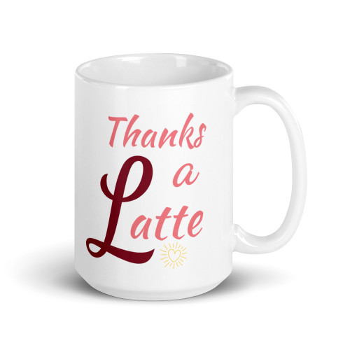 Right side of all white coffee mug with Thanks a Latte on it.