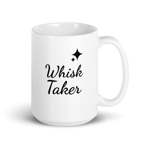 Right side of all white coffee mug with whisk taker on it.
