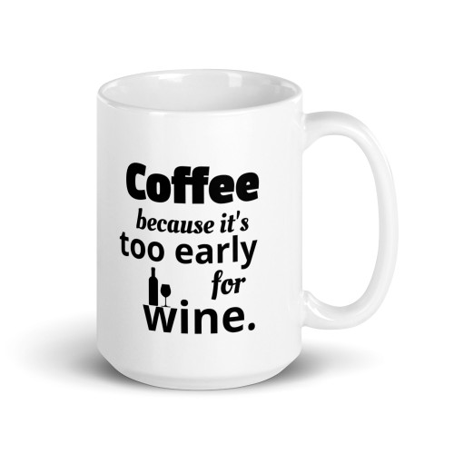 Right side of all white coffee mug with coffee because it's to early for wine and wine bottle and wine glass on it.