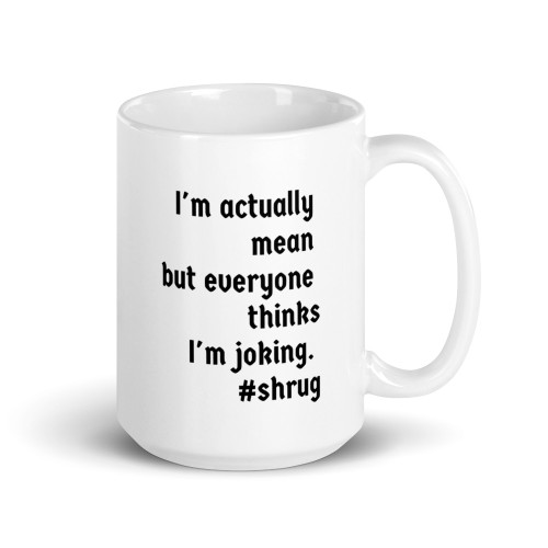 Right side of all white coffee mug with I'm actually mean but everyone thinks I am joking on it.