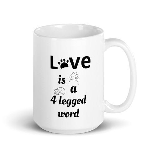 Right side of all white coffee mug with love is a 4 legged word on it.