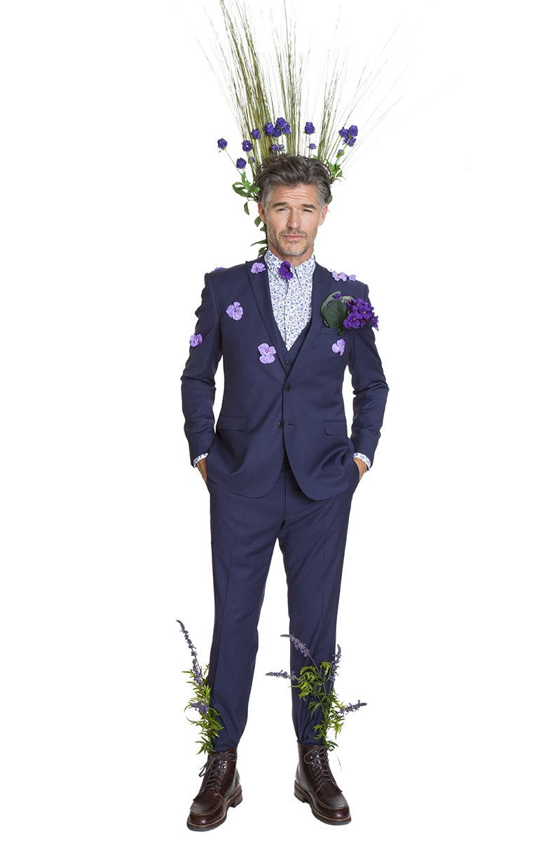 Man with flowers on suit
