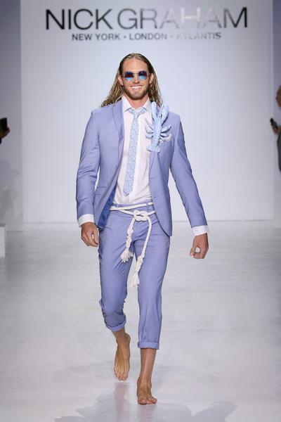 Man in light blue suit