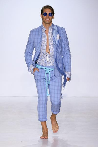 Man in light blue striped suit