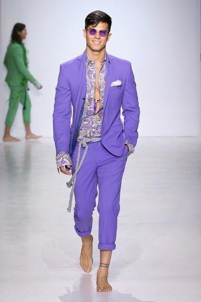 Man in purple suit