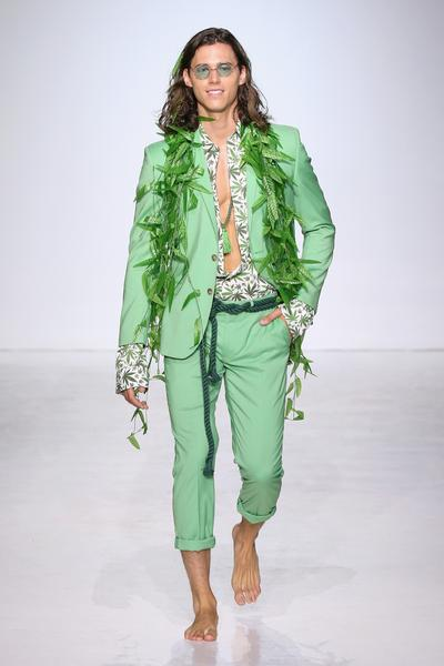 Man in light green suit