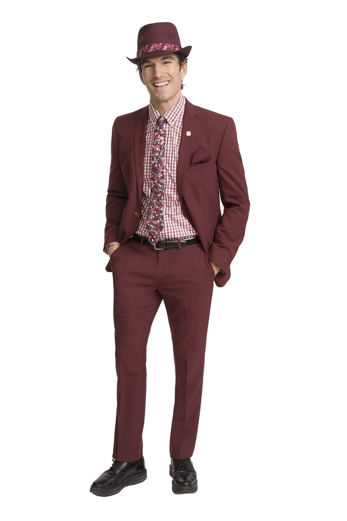 Man in burgundy suit