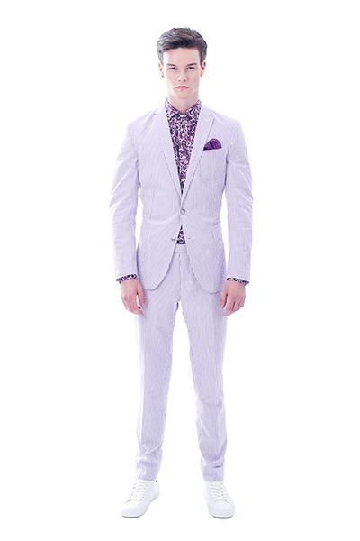 Man in light purple suit