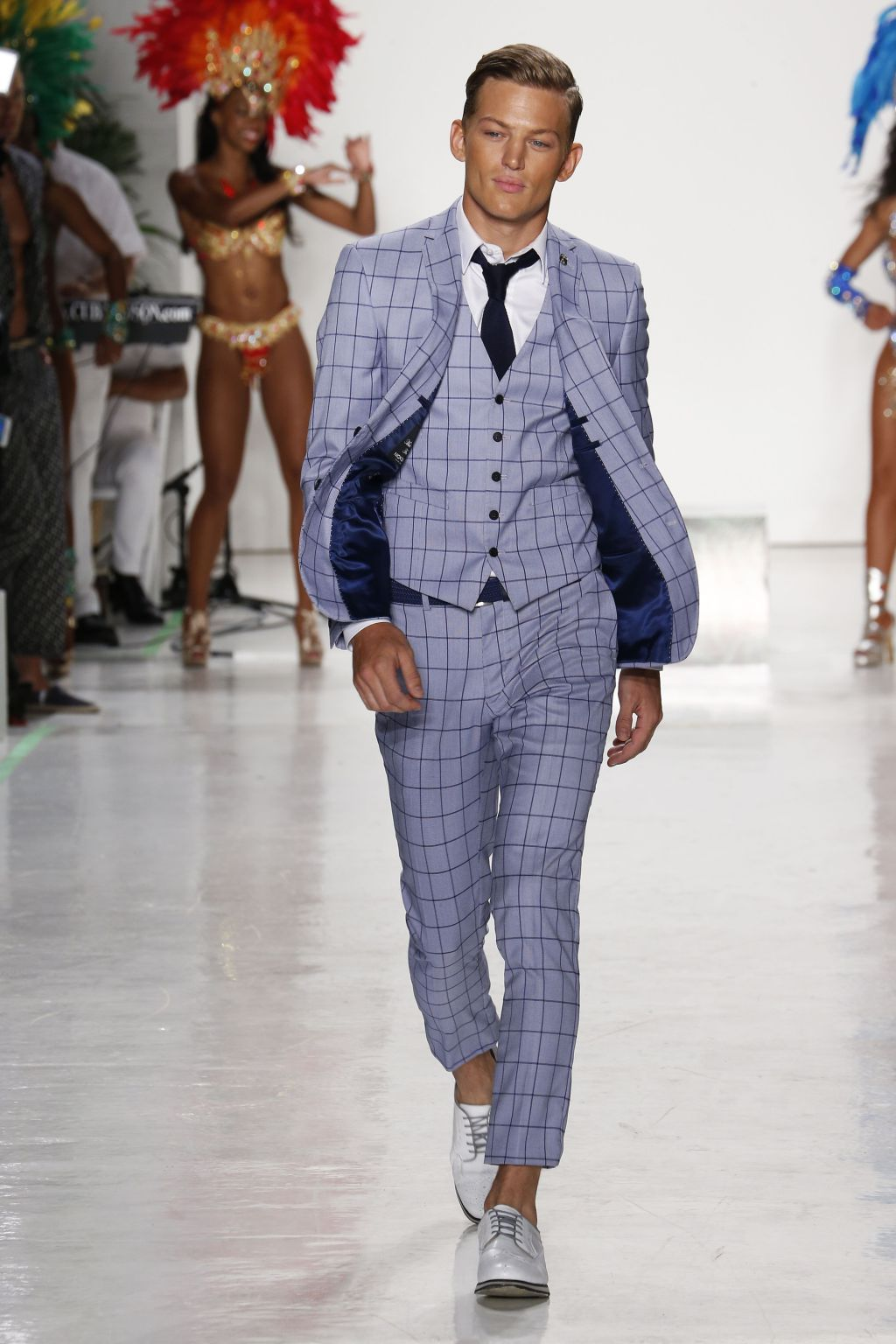 Male in blue three piece suit