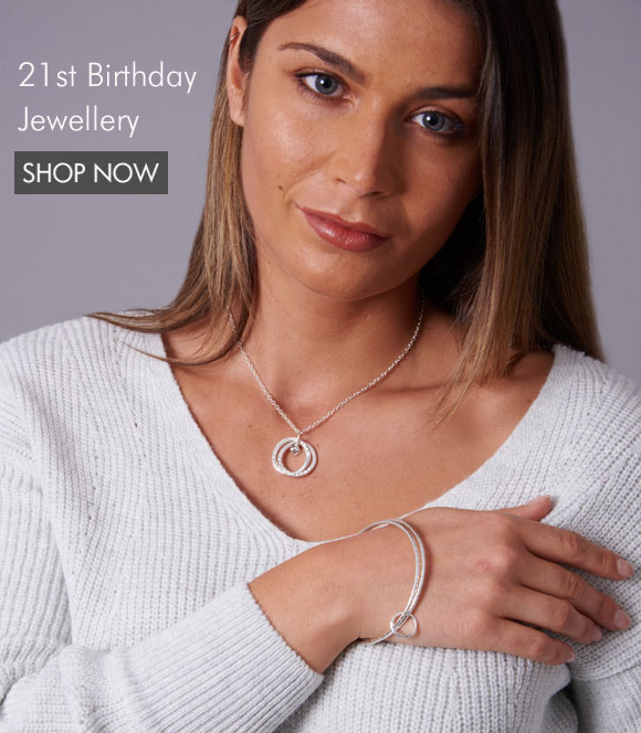a model wearing a 21st birthday necklace and bangle