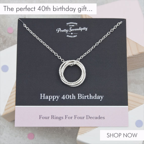 4 rings for 4 decades necklace on black and blush pink gift card