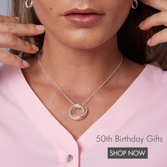 a model wearing a 50th birthday necklace