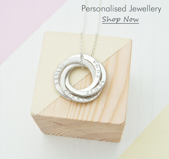 personalised russian 4-ring pendant on wooden block
