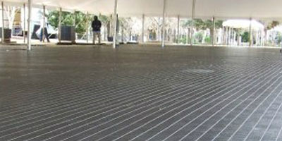 Dance floor covers ground under peak tent