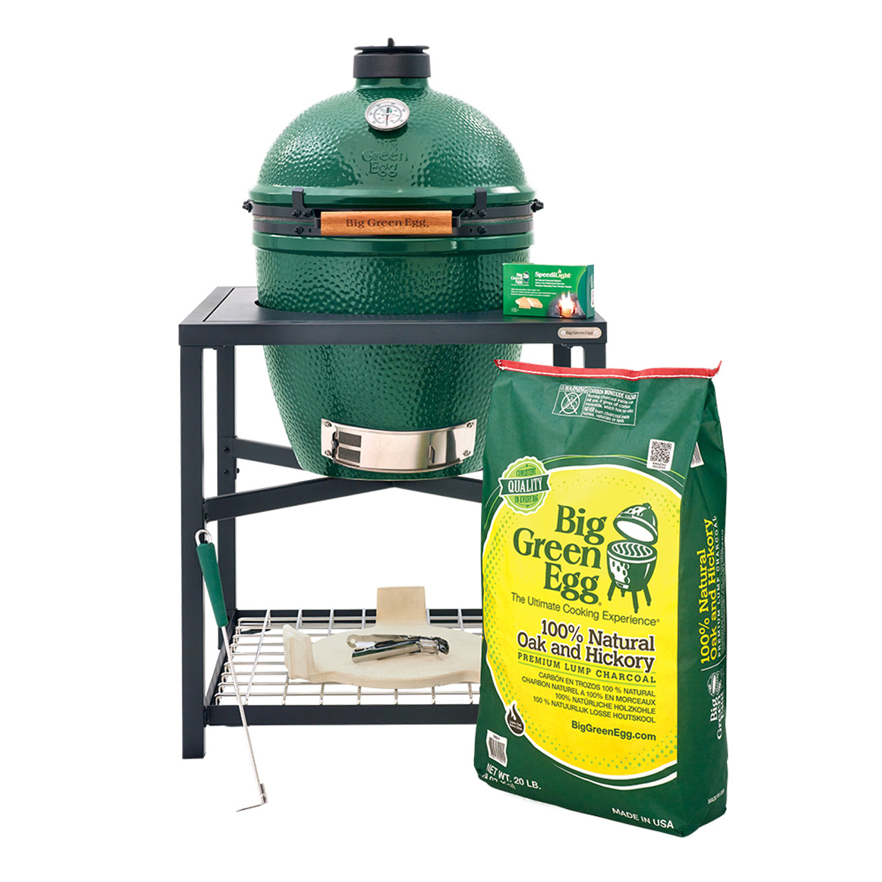 Large Big Green Egg in the modular nest stand and popular accessories: ash removal tool, convEGGtor, 20 pound bag of charcoal, cooking surface lifting tool,  new rEGGulator cap