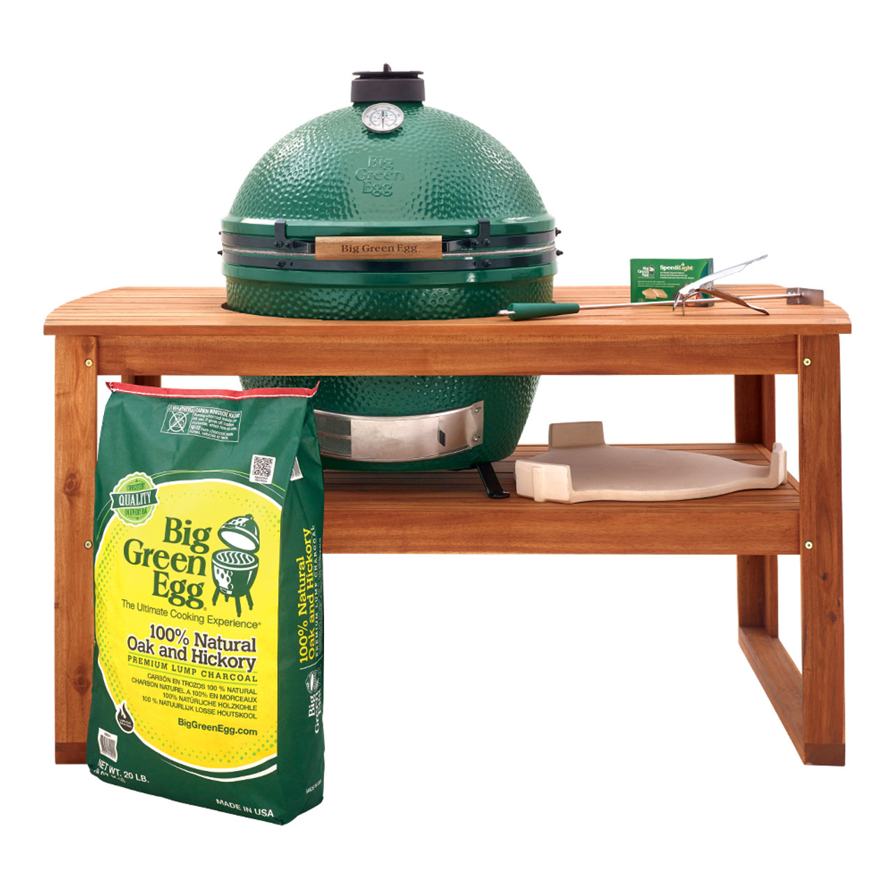 Extra Large Big Green Egg in an acacia table with a lot of EGGsessories