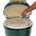 Lifting the cooking surface off a Big Green Egg with hand tool