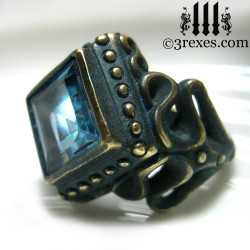 raven love brass wedding ring with large blue topaz stone side detail