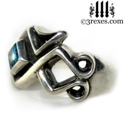 side view celtic ring with blue topaz stone .925 sterling silver gothic mens medieval wedding band, ancient knot