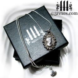 3 rexes prestige box with haunted ghost cameo necklace