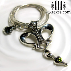 queen of hearts gothic crown necklace with green peridot stone