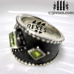silver medieval ring with celtic green peridot side detail