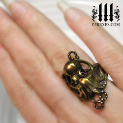 bronze octopus ring with garnet cabochon eyes