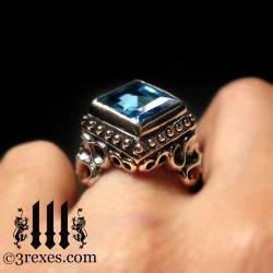 ladies silver gothic wedding ring with blue topaz stone for goth girls