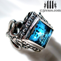 goth wedding ring for her, blue topaz stone alternative promise ring with rocker silver studs
