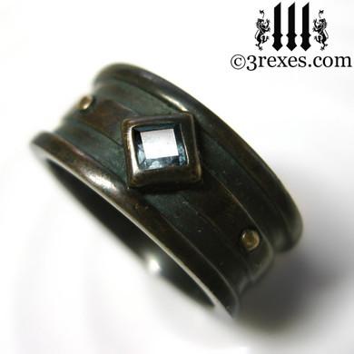 dark brass moorish gothic ring with blue topaz
