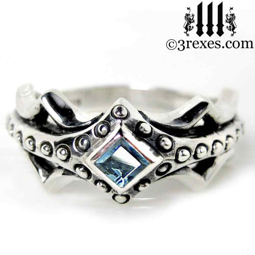 silver medieval engagement ring with blue topaz stone