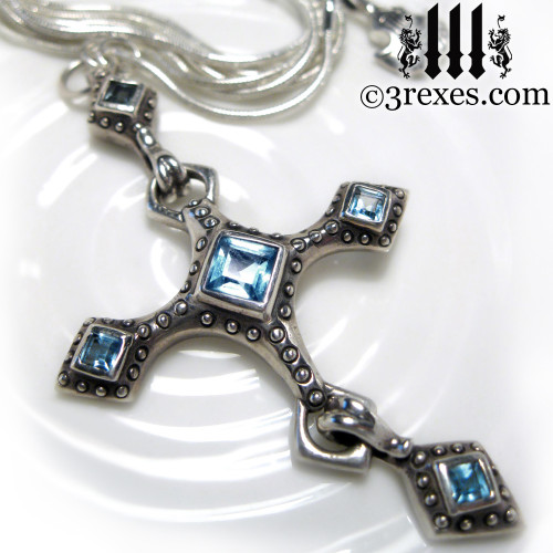 renaissance silver cross necklace with blue topaz stones