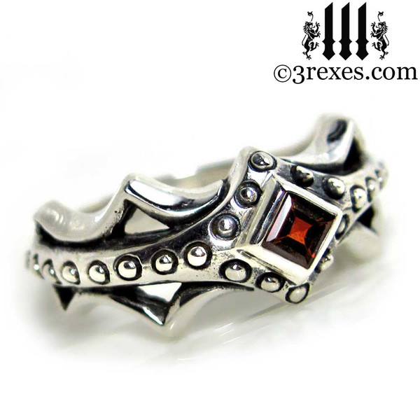 silver medieval engagement ring with garnet stone