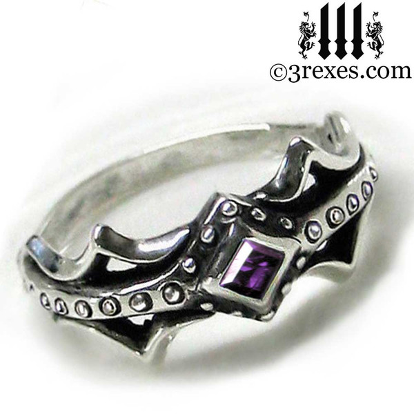 silver medieval engagement ring with purple amethyst stone