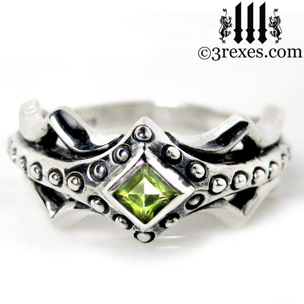 silver medieval engagement ring with green peridot stone