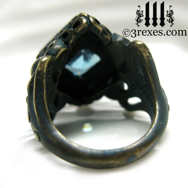 raven love brass wedding ring with large blue topaz stone back detail