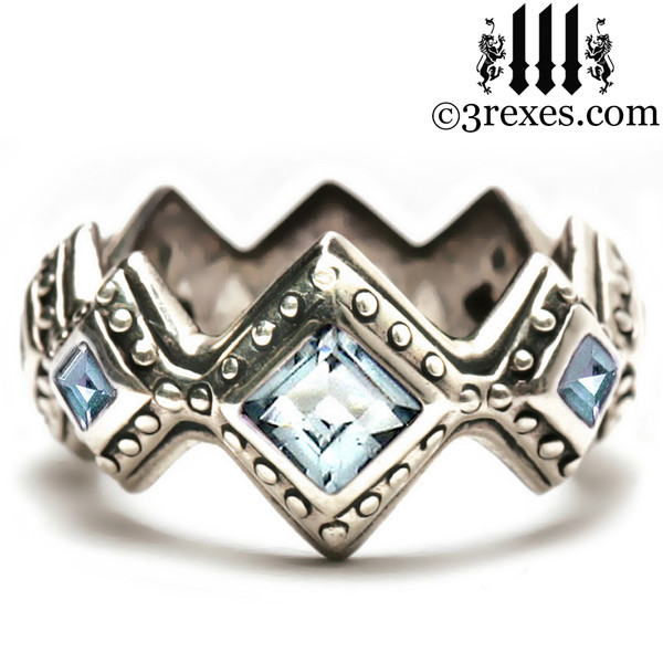 silver renaissance wedding ring with blue topaz stones