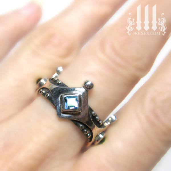 Alt wedding rings, brandy wine medieval crown ring on model with blue topaz stones
