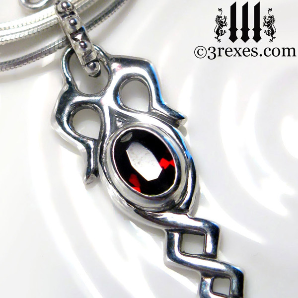 925 sterling silver dripping celtic princess necklace with garnet stone detail view