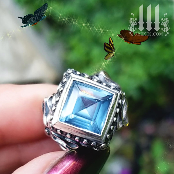 raven love ring blue topaz stone .925 sterling silver gothic fairytale ring with butterflies in a garden