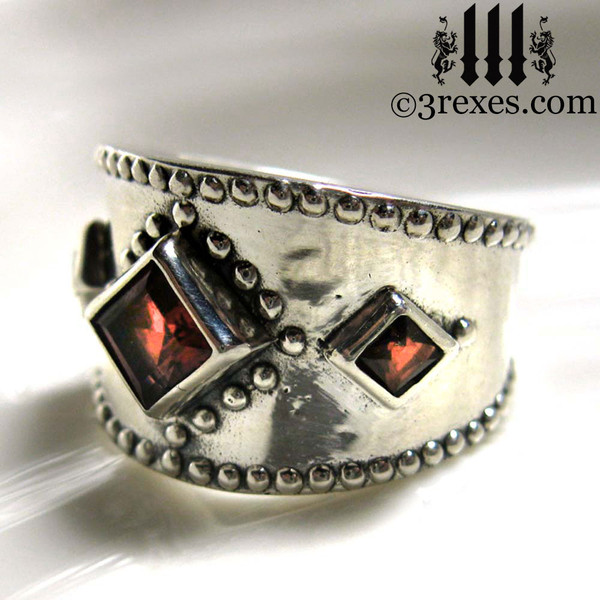 silver medieval ring with gothic light to medium garnet stones