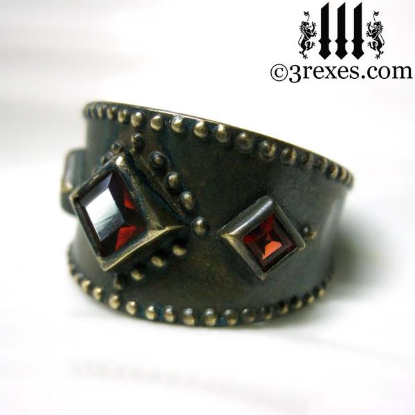 dark medieval wedding ring with gothic garnet